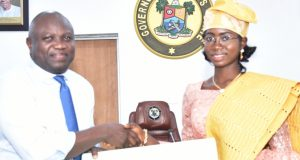 Gov. Ambode and One-Day Governor, Miss Zuffon Bukola from Awodi Ora Senior Secondary School