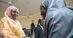 Aisha Buhari giving scholarship to an orphan in Daura