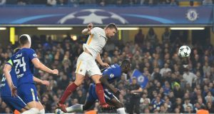 Roma's Bosnian striker Edin Dzeko (C) misses a shot on goal by Chelsea's Belgian goalkeeper Thibaut Courtois (R) during a UEFA Champions league group stage