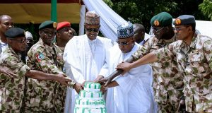 President Buhari, Gov. Shettima and Service Chiefs with troops in Borno