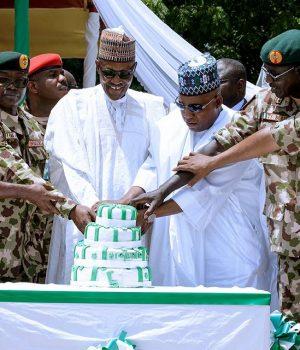 President Buhari, Gov. Shettima and Service Chiefs with troops in Borno