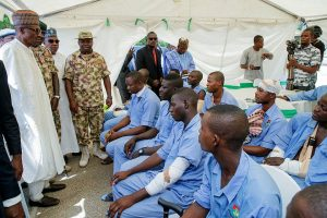 President Buhari, Gov. Shettima and Service Chiefs with some of the wounded troops in Borno
