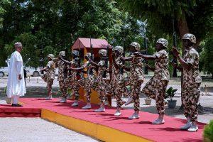 President Buhari takes a salute in Borno