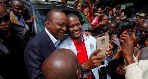 Kenyatta taking selfie with supporters