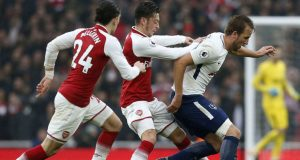 Arsenal's German midfielder Mesut Ozil (C) vies with Tottenham Hotspur's English striker Harry Kane during the English Premier League football match between Arsenal and Tottenham Hotspur at the Emirates Stadium
