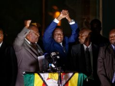 Emmerson Mnangagwa acknowledges cheers from supporters