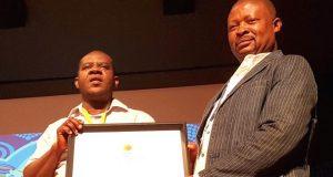 Premium Times' Musikilu Mojeed and Emmanuel Maya at the award presentation in Johannesburg, South Africa