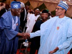 Tinubu exchanging pleasantry with President Buhari