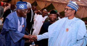 Tinubu exchanging pleasantry with President Buhari