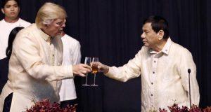 President Trump and Philippines President Rodrigo Duterte , clinging glasses