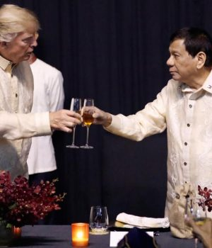 President Trump and Philippines President Rodrigo Duterte , clinging glasses