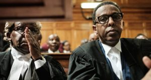 President Uhuru Kenyatta's lawyer Ahmednasir Abdullahi (R) sits with Githu Muigai, the Attorney General of the Republic of Kenya (L), before the hearing seeking to nullify the October 26 repeat presidential election