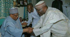 IBB exchanging pleasantry with Atiku during his visit to Minna