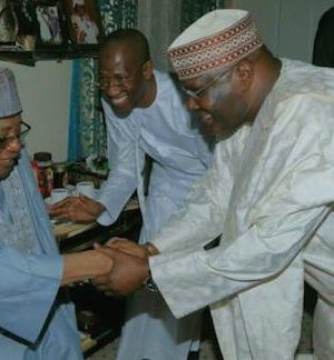 IBB exchanging pleasantry with Atiku during his visit to Minna