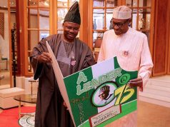 Gov. Ibikunle Amosun of Ogun presenting birthday card to President Buhari