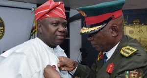 Ambode (left), being decorated with the Armed Forces Remembrance Emblem Appeal by the Chairman, Nigerian Legion, Lagos State Chapter, Col. Samuel Akande, Rtd