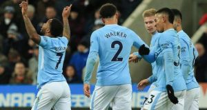 Raheem Sterling celebrates with colleagues