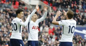 Tottenham Hotspur's Son Heung-min, centre, celebrates with teammate Dele Alli, right and Harry Kane