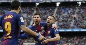 Suarez and Messi celebrate