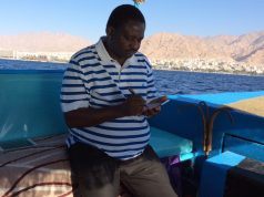 Femi Adesina taking notes while cruising on the Red Sea