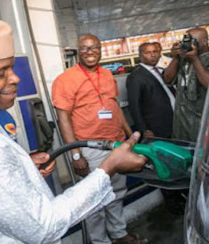 Osinbajo dispensing fuel at a Lagos fuel station
