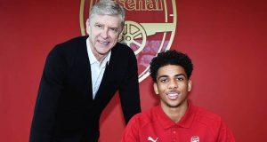 Arsenal manager, Arsene Wenger and Xavier Amaechi