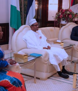 President Muhammadu Buhari (M) flanked by the Minister of Foreign Affairs, Geoffrey Onyeama and Rwanda Envoy and Minister of Foreign Affairs, Cooperation and East African Community, Ms Louise Mushikiwabo during an audience at the State House in Abuja.