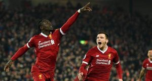 Sadio Mane celebrates Liverpool's third goal against City