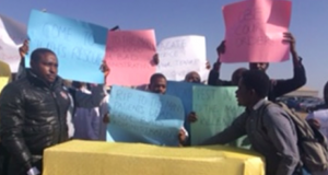 Protesting JUTH doctors with mock coffin