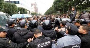Tunisia police.confronting protesters