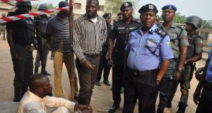 Lagos CP, Imohimi Edgal addressing the press while the suspect Kayode Abdul-Fatai looks on