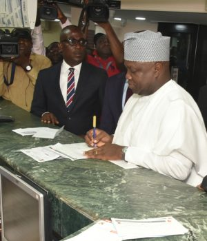 Gov. Ambode filling his Land Use tax teller at the GTB branch