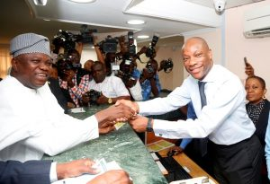 Gov. Ambode being given his Land Use charge receipt by GTBank GMD, Segun Agbaje