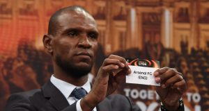 Barcelona and Lyon's former player Eric Abidal shows the name of Arsenal FC during the draw for the round of 16 of the UEFA Europa League football