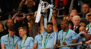 Man City players celebrate the Carabao Cup