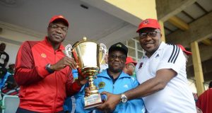 L-R: General Manager External Relations of Shell Petroleum Development Company (SPDC), Igo WelI; Group Managing Director of Nigeria National Petroleum Corporation, Dr. Maikanti Baru; and SPDC Community Relations Coordinator Alex Onumbu, at the presentation of the 2018 NOGIG Overall Tournament Champion trophy to SPDC in Lagos… on Saturday.