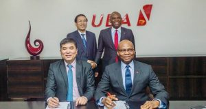 Officials of UBA and CDB after signing the agreement
