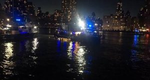 Helicopter crashes into East River of New York City
