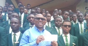 Fmr. Gov. Peter Obi (middle) presenting a cheque of 1 million Naira to Christ the King College, Ijebu Ode, for continued infrastructure improvement.