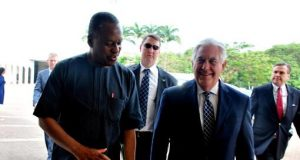 Nigeria's Minister of Foreign Affairs,Geoffrey Onyema leading Rex Tillerson to a meeting with President Buhari
