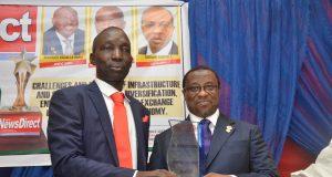 Samuel Ibiyemi presenting the award to Dr. Maikanti Baru of NNPC