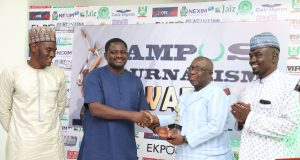 Femi Adesina presents award to Dapo Olorunyomi