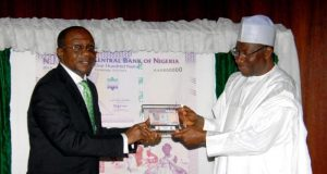 CBN Gov. Godwin Emefiele and then President Goodluck Jonathan unveiling the new N100 note then