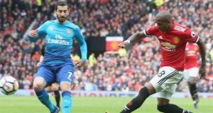 Ashley Young scores against Arsenal