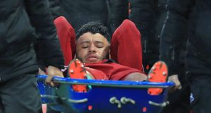 Alex Oxlade-Chamberlain stretchered out during Liverpool and Roma encounter