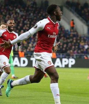 Danny Welbeck celebrates his third goal in two games as he sent Arsenal into the draw for the Europa League's last four