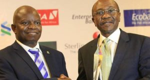 CIBN President, Professor Segun Ajibola handing over the award to Emefiele