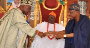 Lai Mohammed exchanging pleasantries with Ajase Ipo traditional ruler, seated is the Olofa of Offa, Oba Muftau Gbadamosi