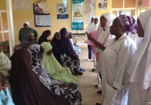 Pregnant women being counselled outside