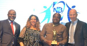 Uche Unigwe, Sales Director, NB Plc; Mrs Ebere Maduakor; Mr. Kenneth Maduakor, Chairman, Ken Maduakor Group Limited, winner, National Champion Award/2017 Best Distributor; and Mr. Jordi Borrut Bel, Managing Director, Nigerian Breweries at the Company's Distributors Award in Lagos